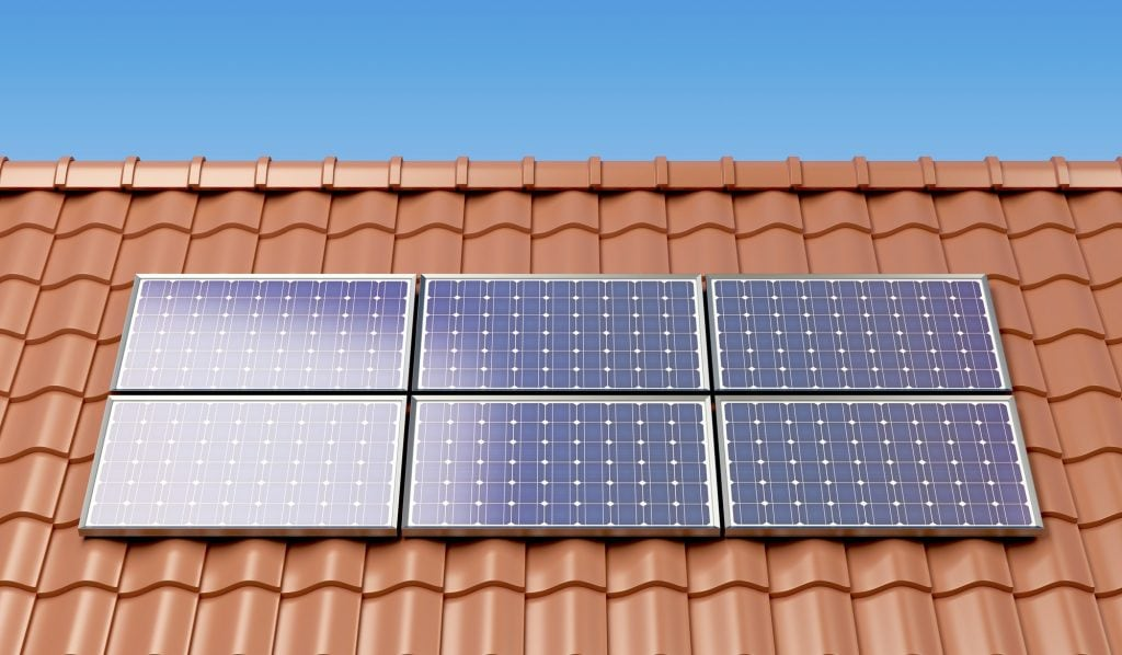 Solar panels on the roof of a house, producing electricity